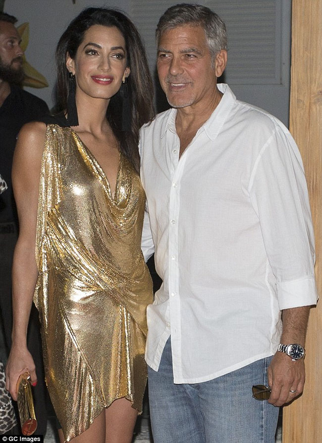 amal clooney in gold dress and george clooney ibiza