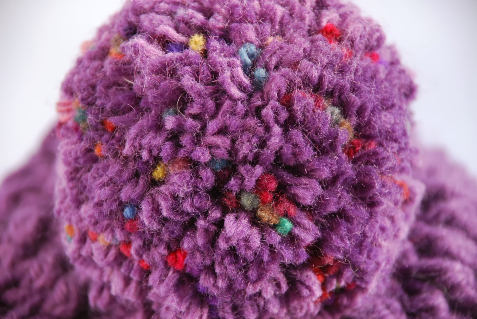 image of pom pom on crocheted hat