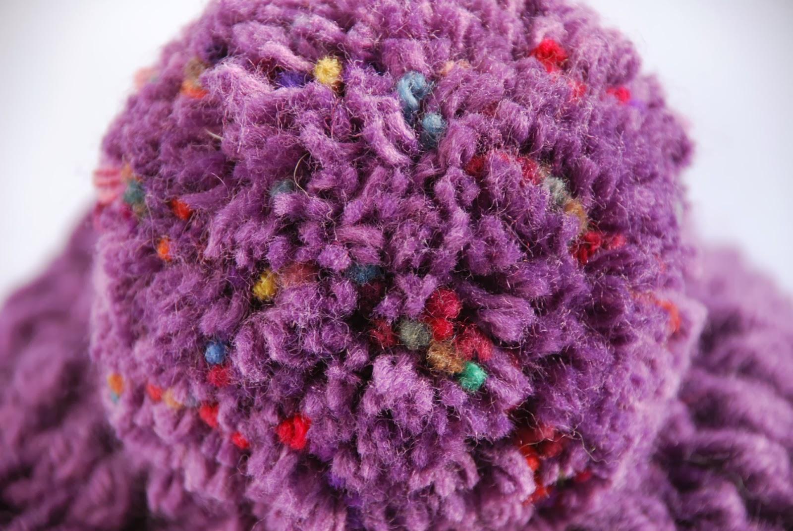 image of pom pom on crocheted hat