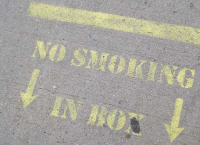 Close up of the lettering, which reads No smoking in box