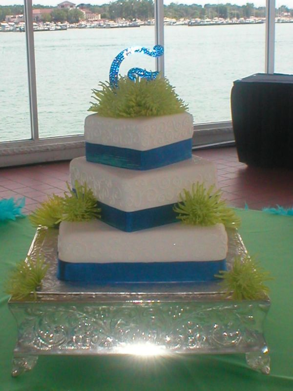 Lime green and blue wedding cakes