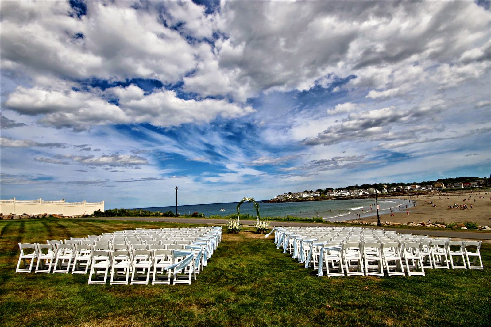 The Ceremony Took Place On Lawn Overlooking Short Sands Beach Where Families Laid Out And Boats Ped By In Ocean