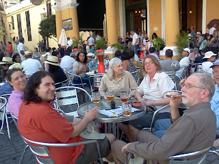 David, Cynthia, Pam, Sarah, Steve (partial) and Dane in Plaza Vieja enjoying Cuban cigars and beer