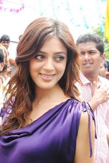 Parvathi Melton in purple dress    com 13829351087ef3e140132f3a556a8c674e0052aa