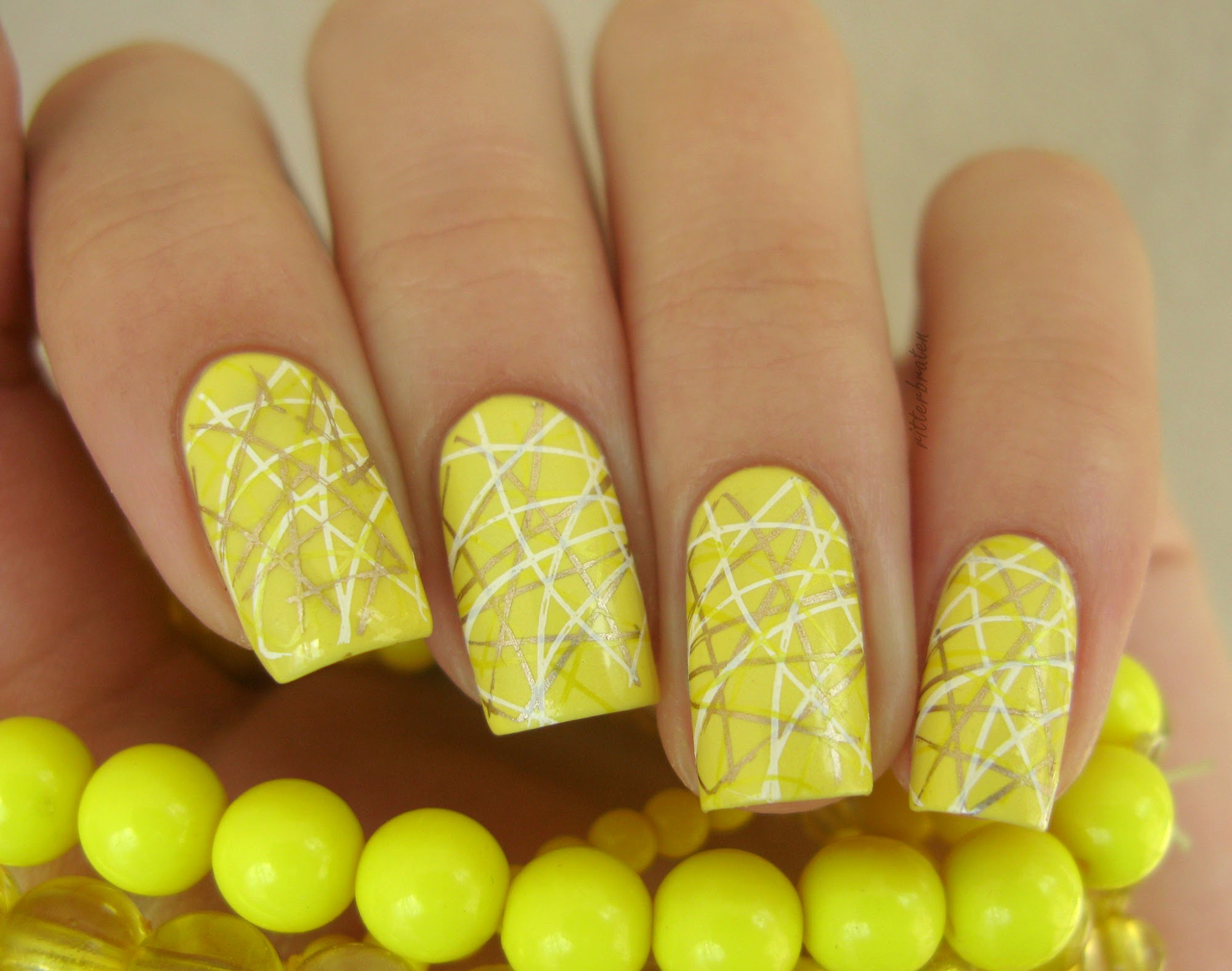 yellow stamping nail art