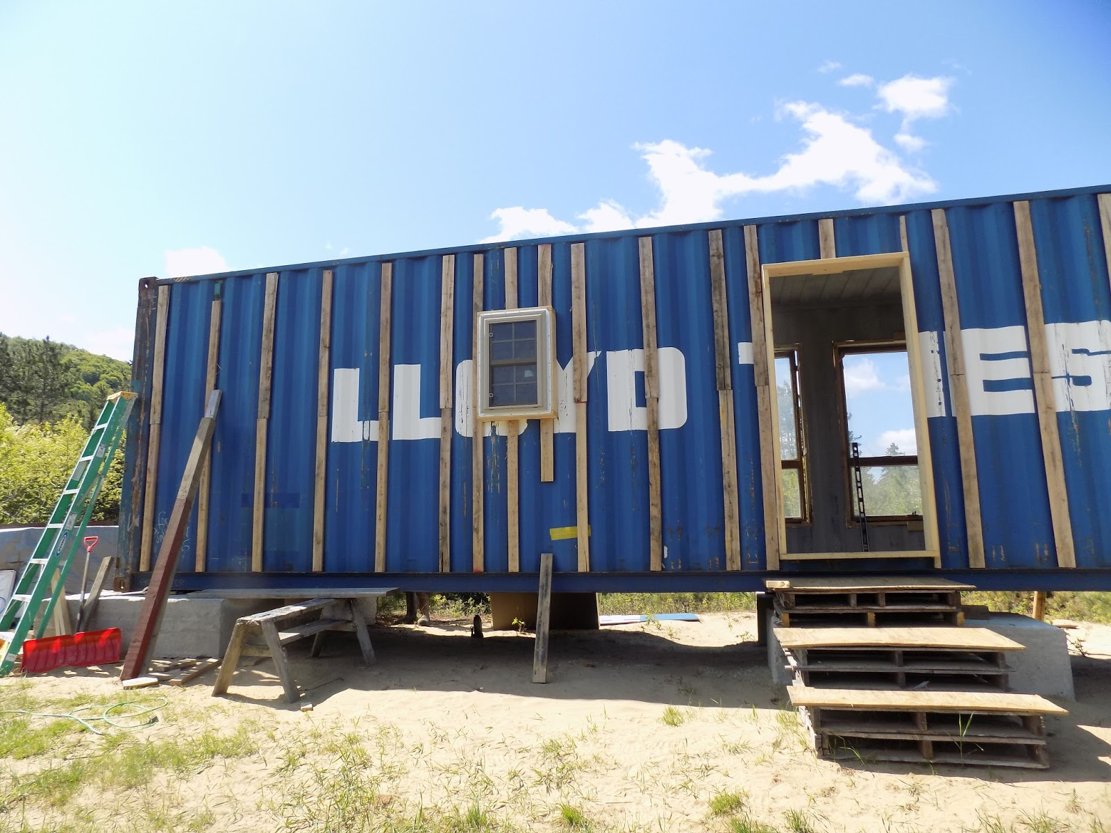 Container Home Siding : Intermodal house strapping on windows in insulation