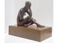 Seated bronze nude on fabricated bronze base by Marianne Hornbuckle