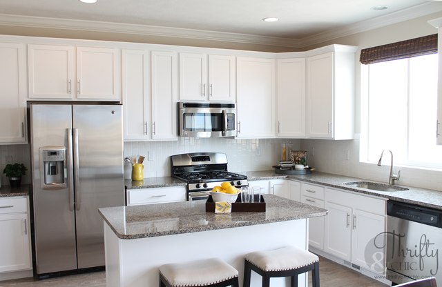 White and grey kitchen with subway tiles