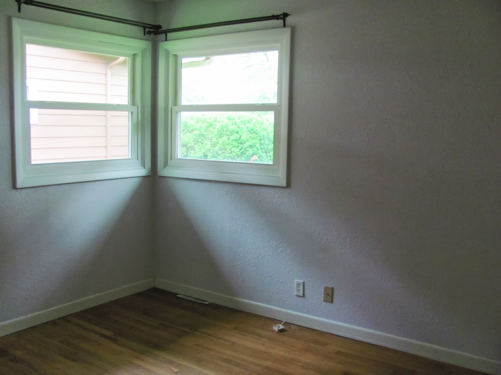 The second bedroom is seen from the hallway, empty