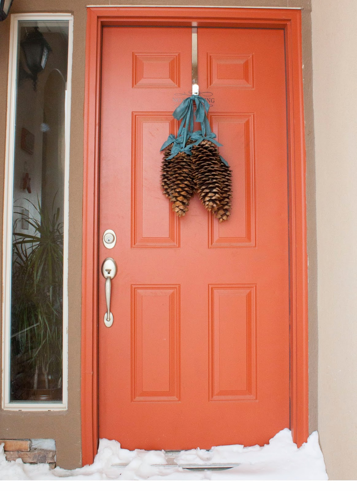 Creatively christy diy pine cone door decor for Decor to your door