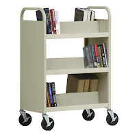 Book shelving cart with books on it