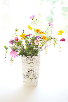 Tickled by the Creative Bug - Colorful wildflowers in a white vase against a bright white background