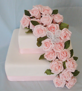 2 tier wedding cake with pink roses and butterfly