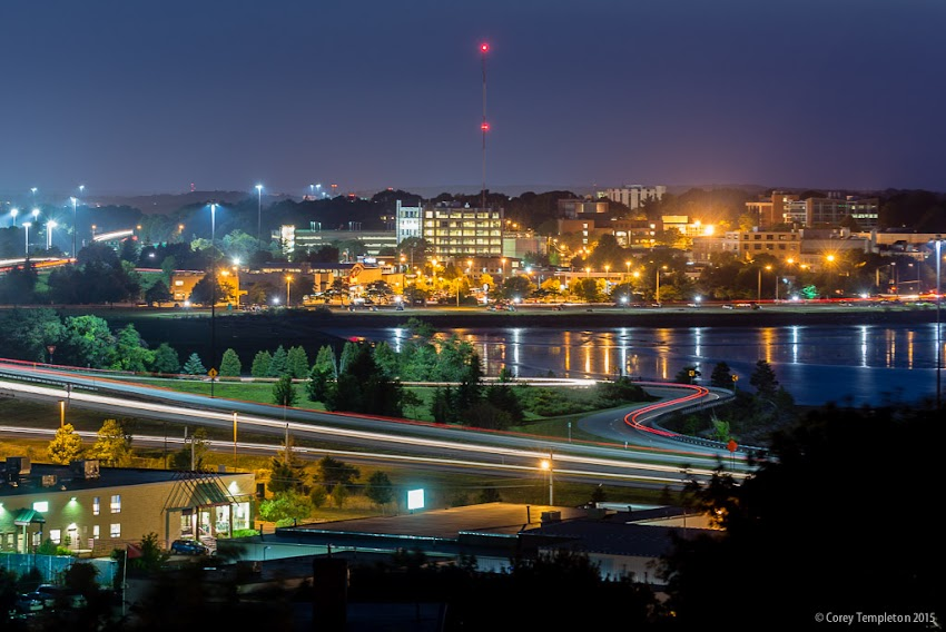 August 2015 Portland, Maine USA Photo by Corey Templeton. From Jack Path (part of the Portland Trails network) looking out across Back Cove and towards the University of Southern Maine's Portland campus at night.