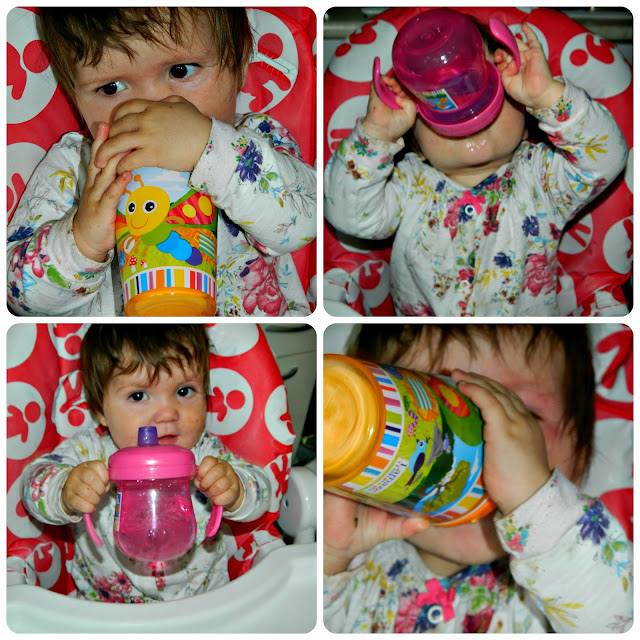 Baby girl drinking from her TOMY Lamaze cups