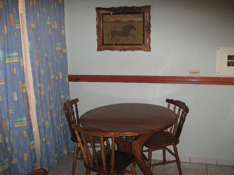 The dining room set made from cinesero wood. title=