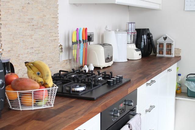 Mandarin Stone splitface natural stone kitchen splashback and border