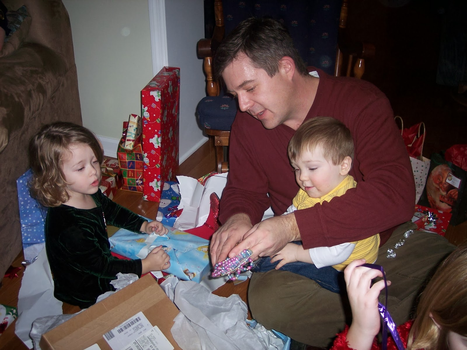 The Best Gift – a Happy Family All Wrapped Up in Each Other | Ann H ...
