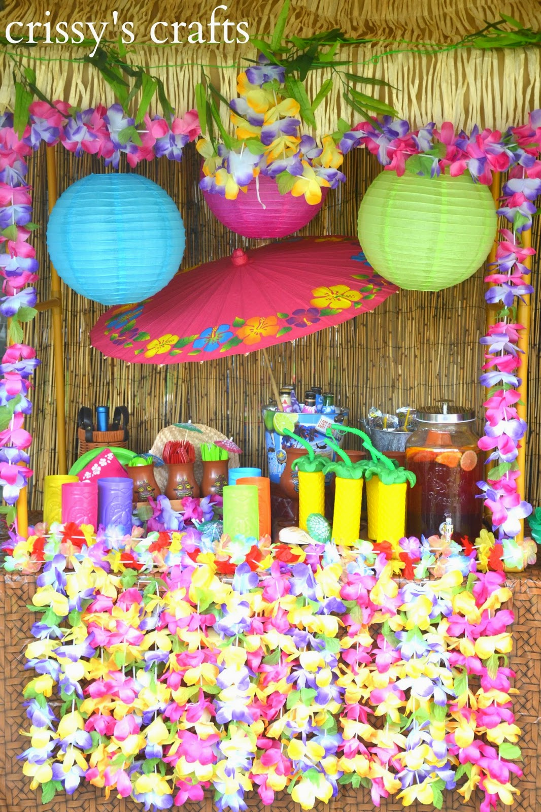 We Set Up A Tiki Bar By Using Our Tabletop Luau Hut And Decorating It With  Paper Lanterns, Hibiscus Print Parasols And Hawaiian Leis.
