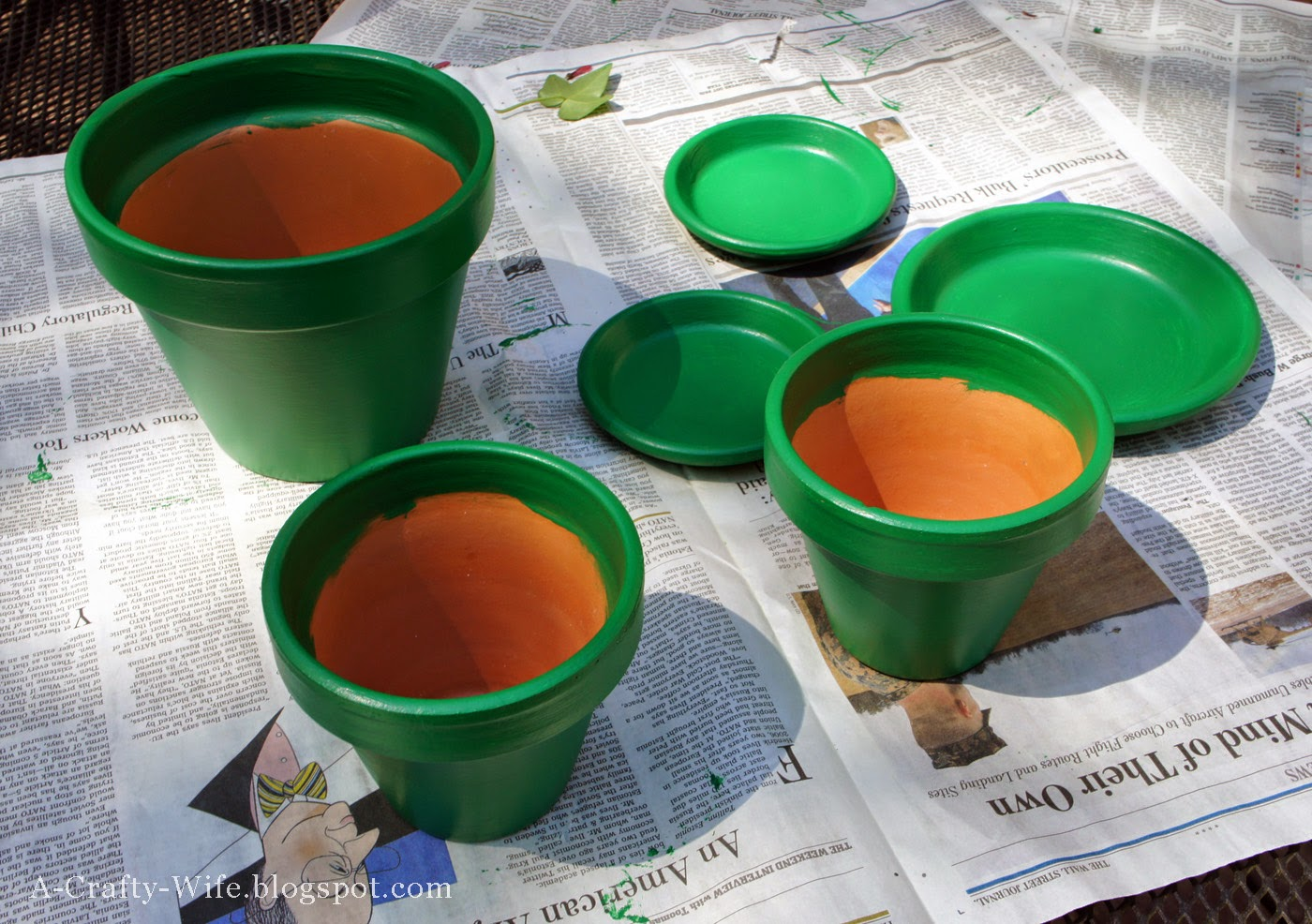 Small terra cotta pots painted with latex paint and then stenciled | A Crafty Wife