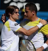 Ferrer y Nico se saludan tras el partido