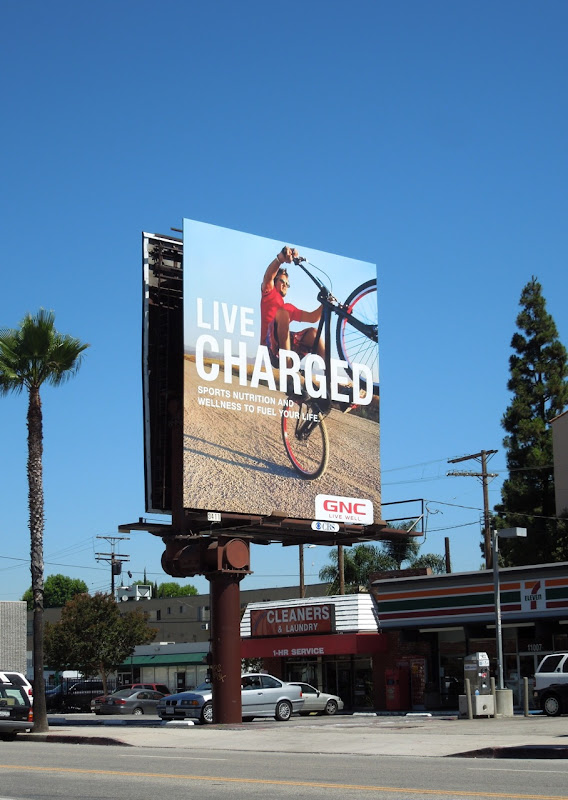 Live Charged cyclist GNC billboard