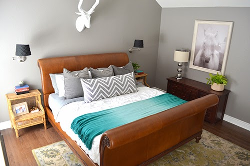 Elegant We are so thrilled with how the bed brings the whole room together The yummy brown leather warms up the grey and white color scheme and I love how the