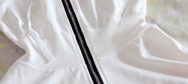 Close-up of the form-fitting shirred waistband on the hoodie-style Romwe dress.