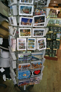 A rack of postcards on display at a souvenir shop in Melbourne, Australia.