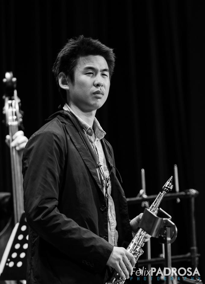 Kevin Sun on soprano saxophone, contemplating