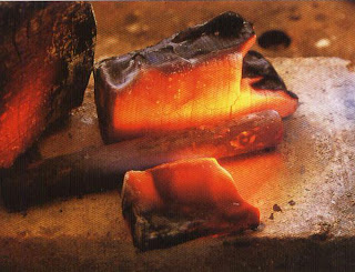 Making a punch Heat a piece of tool steel about 4 inches long and with a diameter of about 5/8 inch. Pack charcoal blocks around it and use a large torch. Heat the steel until it is cherry red, hold it at that color for a few seconds, and then allow it to cool naturally
