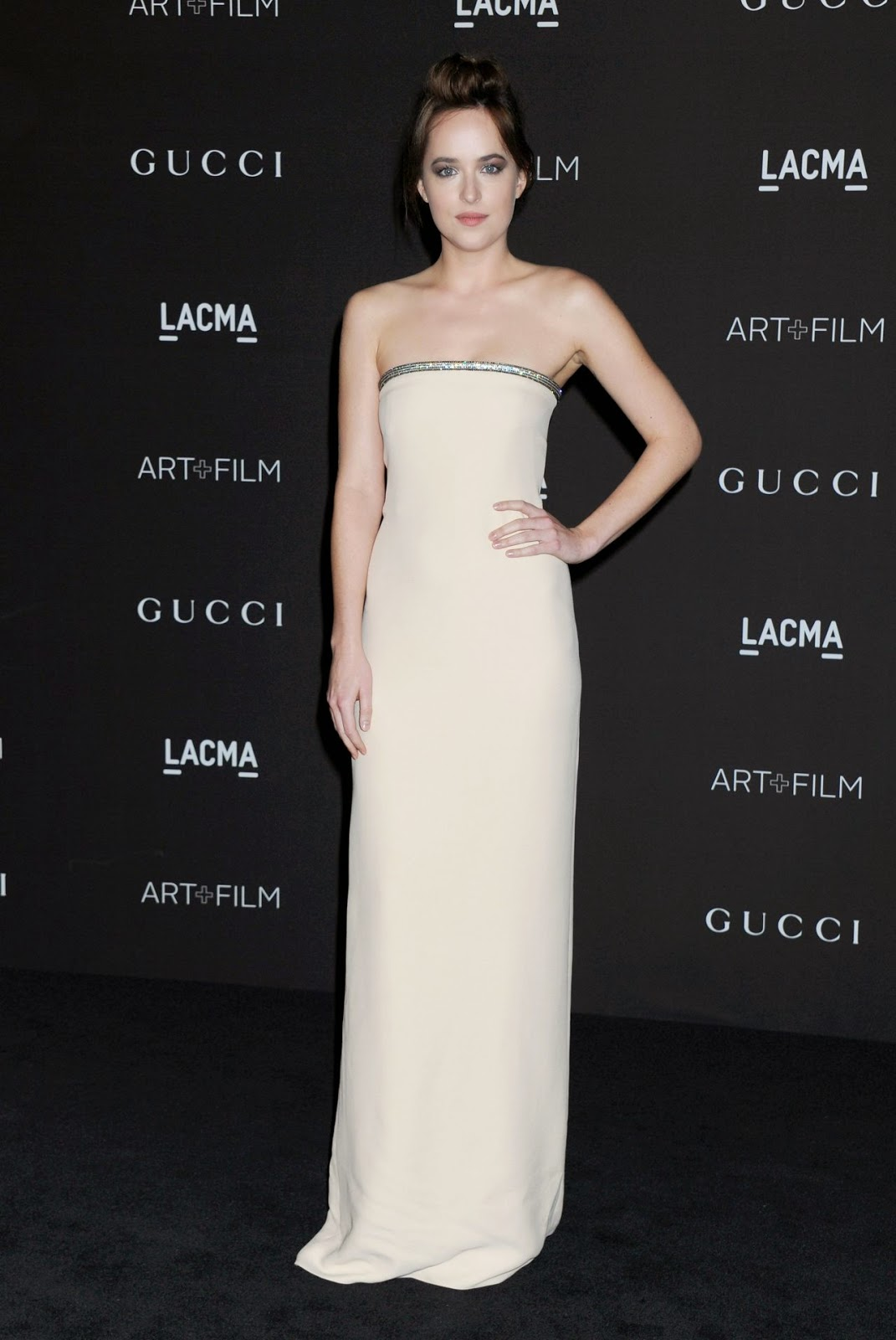 Dakota Johnson is flawless in a strapless gown at the 2014 LACMA Art + Film Gala