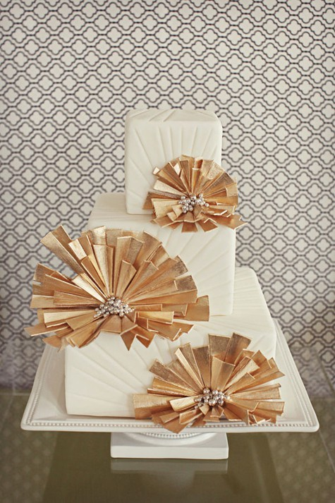 An amazing white and gold Art Deco cake by Bliss Wedding and Event Design