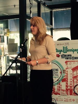 Cindy Tugwell, Heritage Winnipeg Executive Director, presents the award.