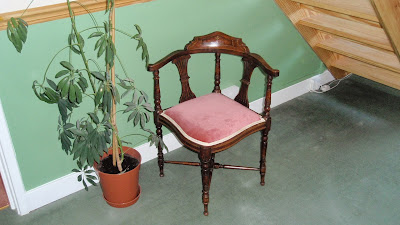 A photograph of a restored Edwardian corner chair