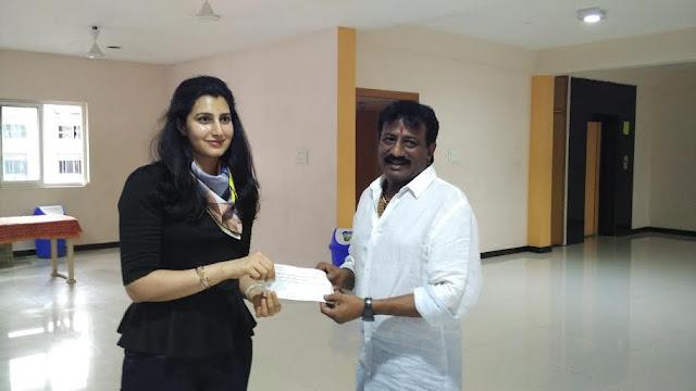 Sai Korrapati hands over AP Capital fund check to Nara Brahmini