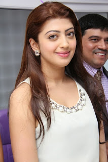 Actress Pranitha Pictures in White Dress at Homeo Trend Super Speciality Hospital Launch  0055