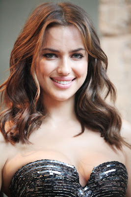 Irina Shayk flaunts her assets in tight bra top