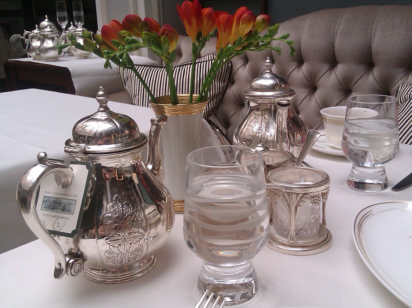 silver teapots and flowers