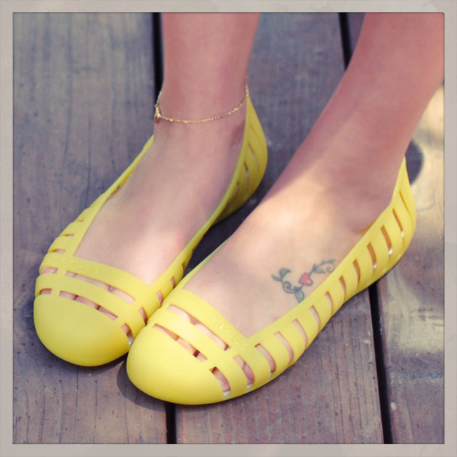 cute yellow jelly slip ons, foot tattoo