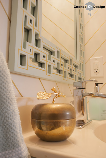gold striped powder room with mint and gold mirror