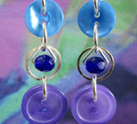 Stunning Blue Long Strand Earrings have Small Beads Encircled in Silver Rings as a Focal Point Between 2 Pretty Buttons