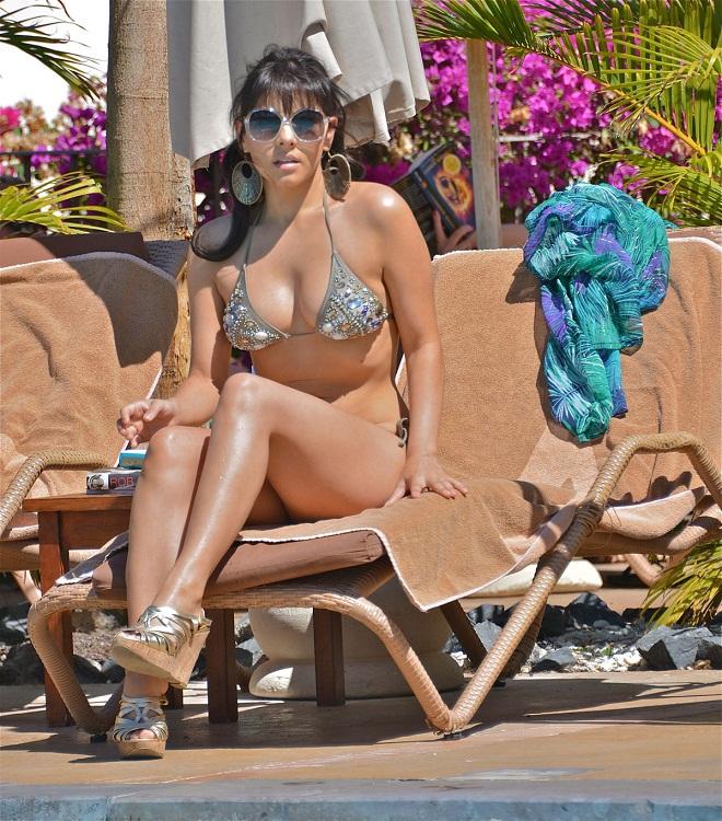 Roxanne Pallett shimmers in an embellished silver bikini