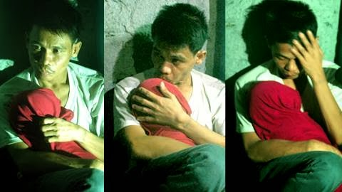 Marlon de Leon carrying the body of his dead son, Kevin