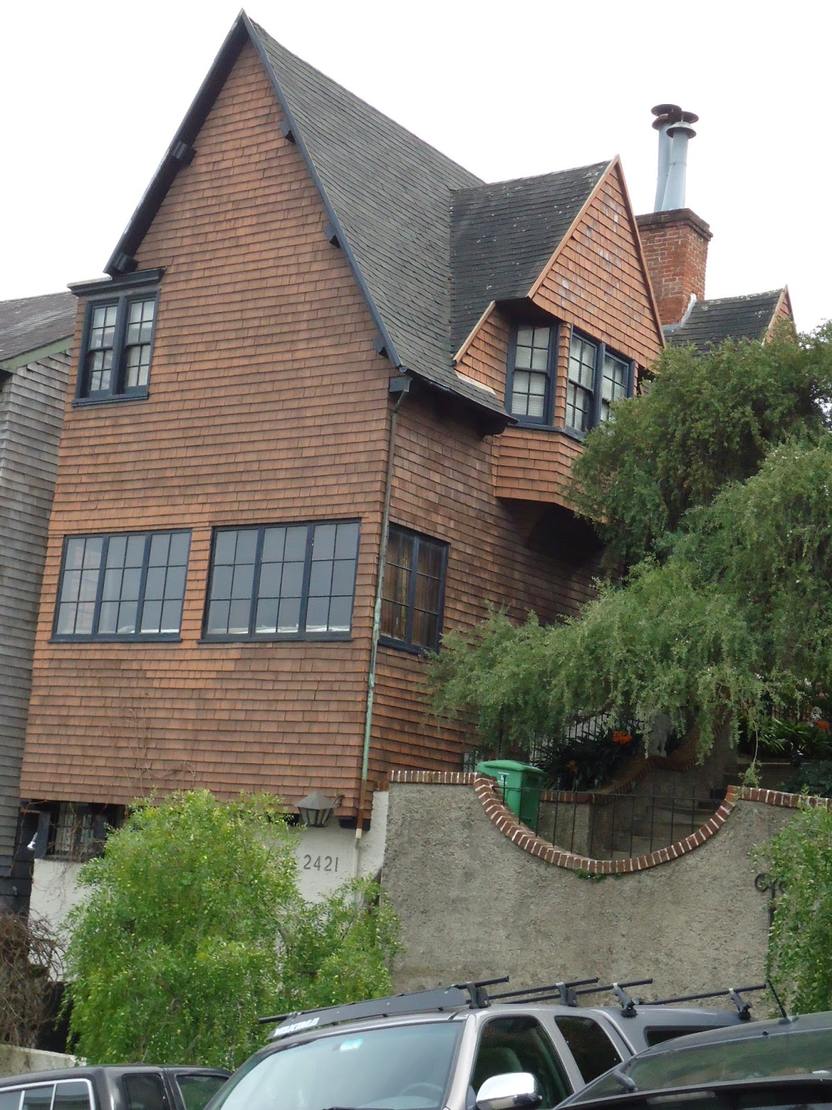 Note the shingled dormers and the steeply sloped roof whose shingles comprise more than half of the homes facade coxhead built a house for himself right