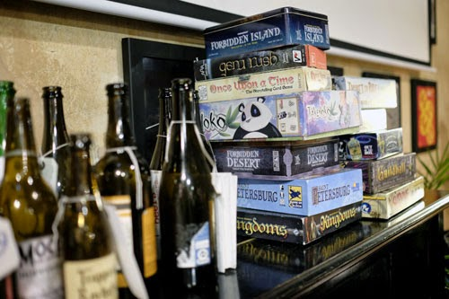Stack of board games in a bar