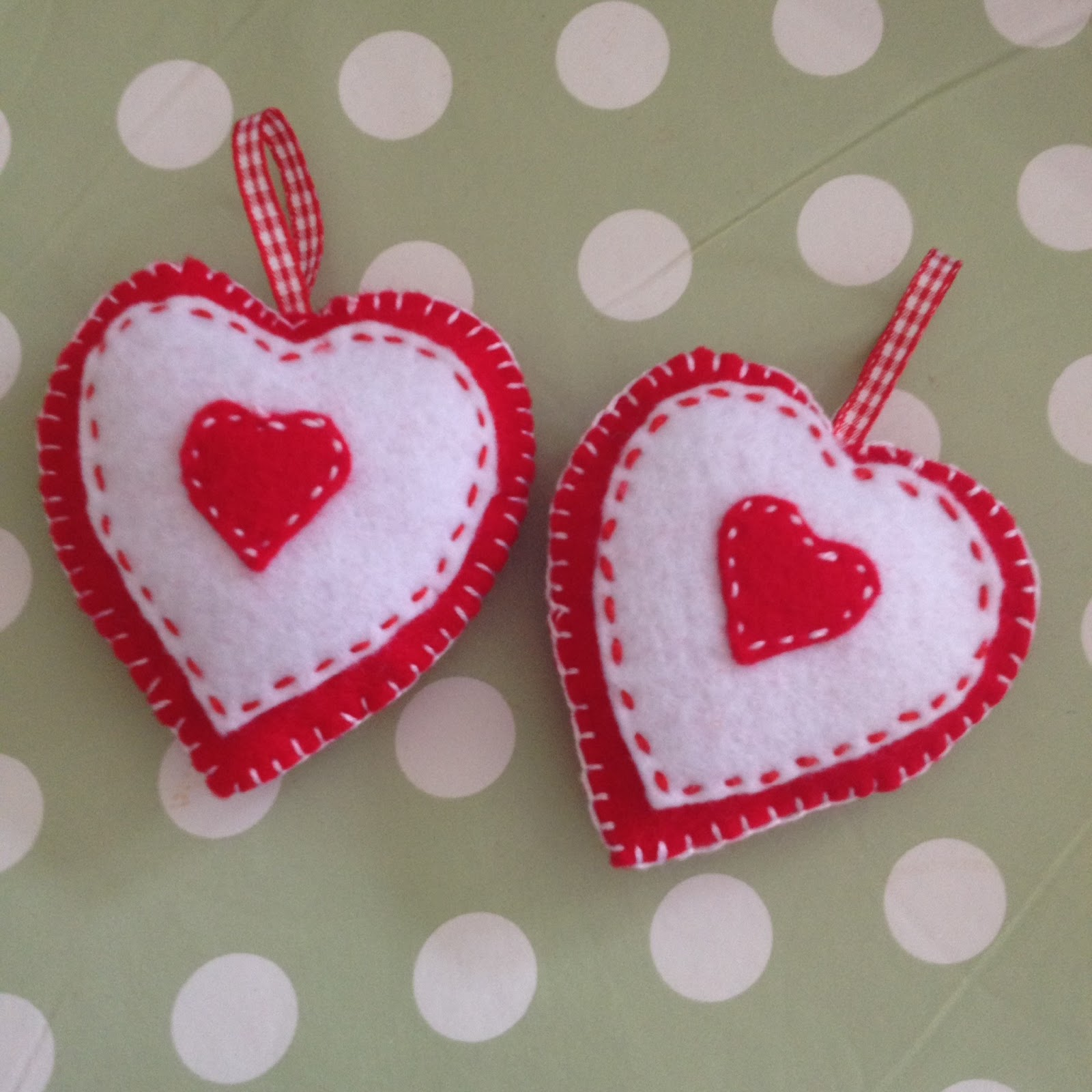 handmade red and white christmas hearts