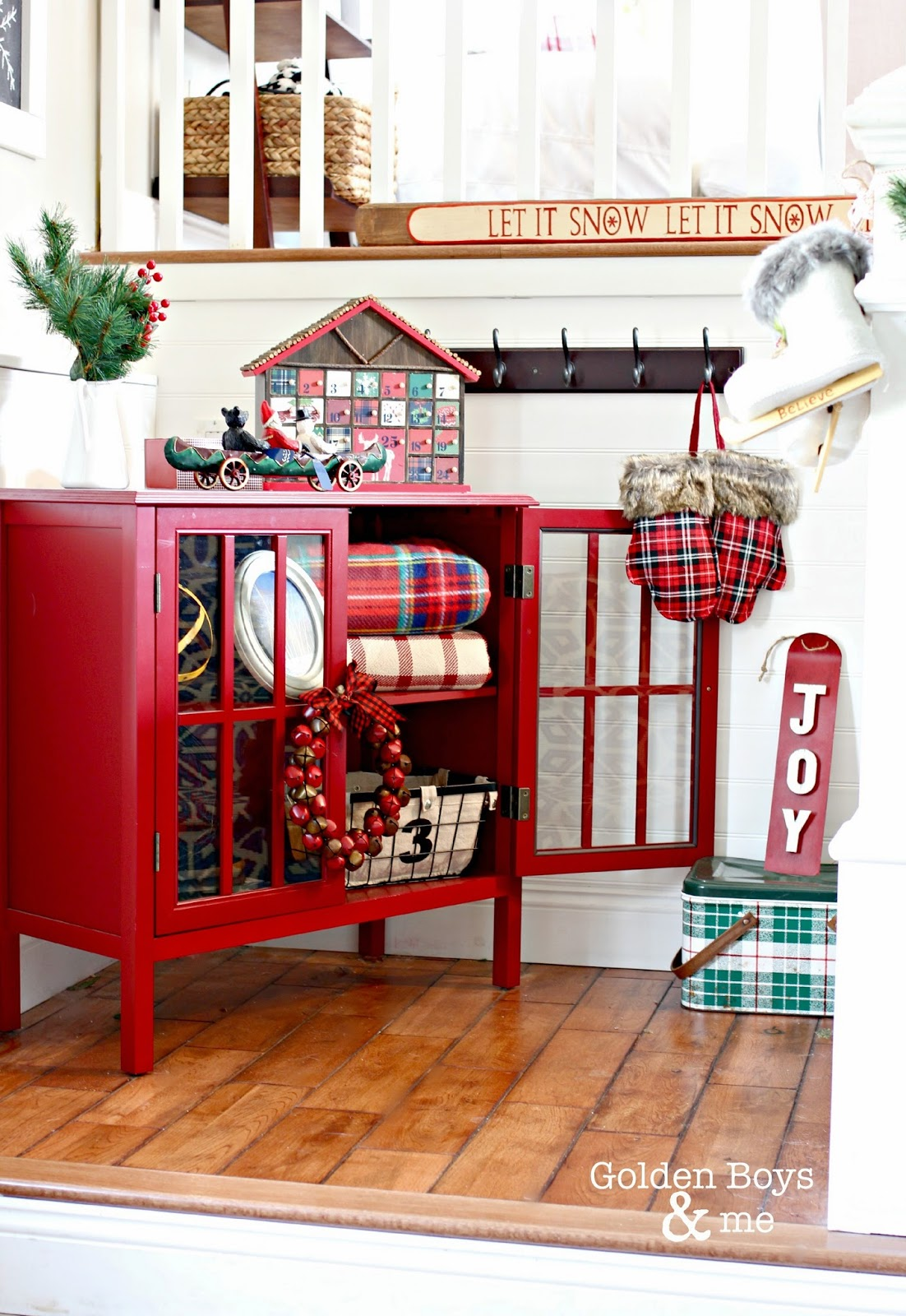 Rustic lodge style Christmas entryway in split level home with Target bookcase-www.goldenboysandme.com