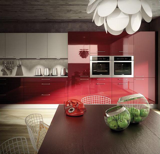 La vue de face de cette cuisine design rouge brillante.