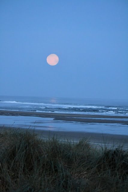 photo of the moon setting over the Pacific Ocean at Rockaway Beach